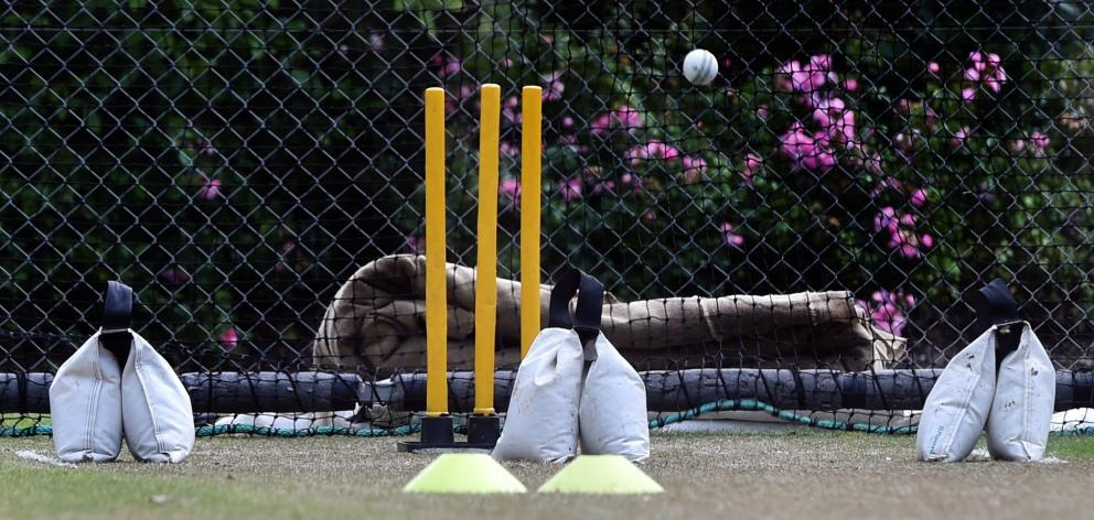 The  weight bags are positioned at the wide lines and where the batsman's  toes would be.