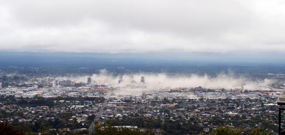 A photograph taken of Christchurch from the Port Hills just 7 minutes after the quake hit on...