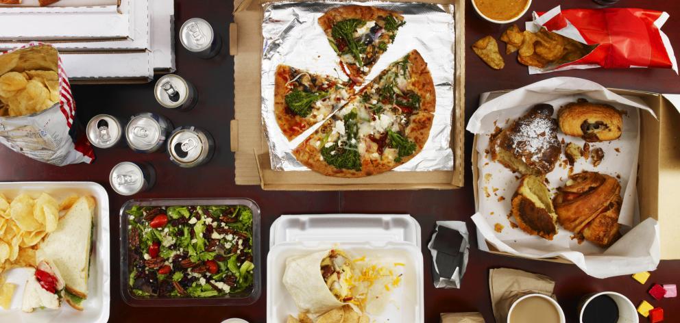 Junk food dinner feast. Getty Images