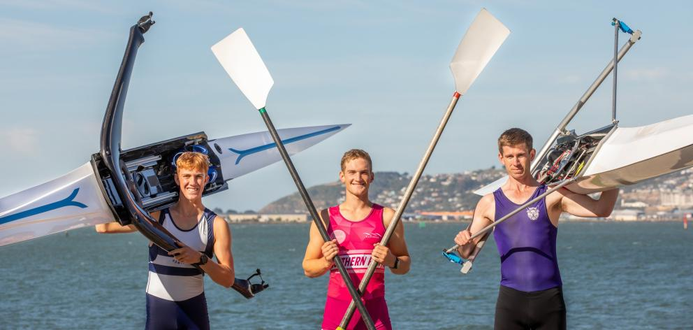 Rowers (from left) Reuben Cook, Ben Mason and Lawson Morris-Whyte on the Otago Harbour shoreline....