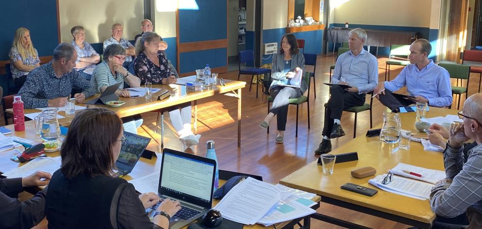 Members of the Waikouaiti Coast Community Board and public listen as (from left) medical officer...