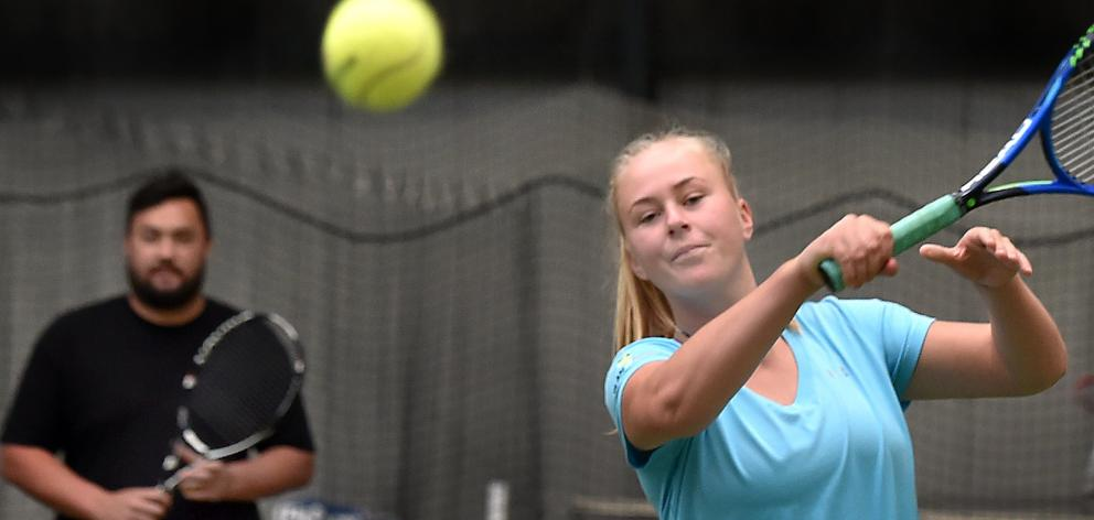 Ivy McLean, watched by Jaden Grinter, hits the ball at the Edgar Centre in Dunedin yesterday....
