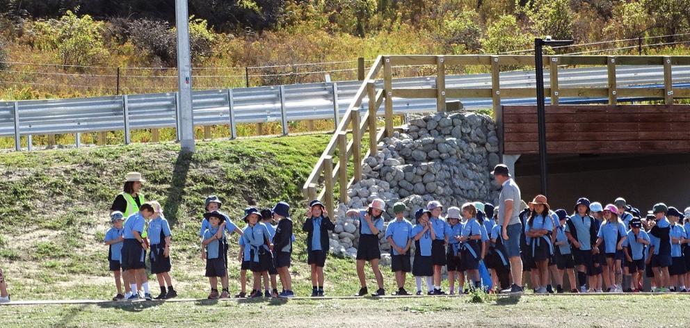 Te Kura O Take Karara school teacher Caitlin Crampton leads a group of year 3 and 4 pupils '...