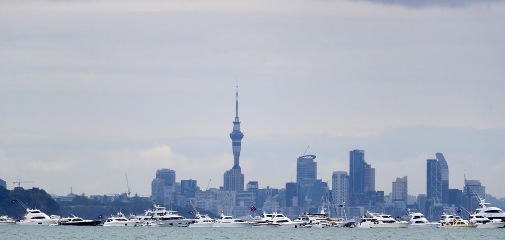 Spectator boats line the America's Cup course in Auckland.