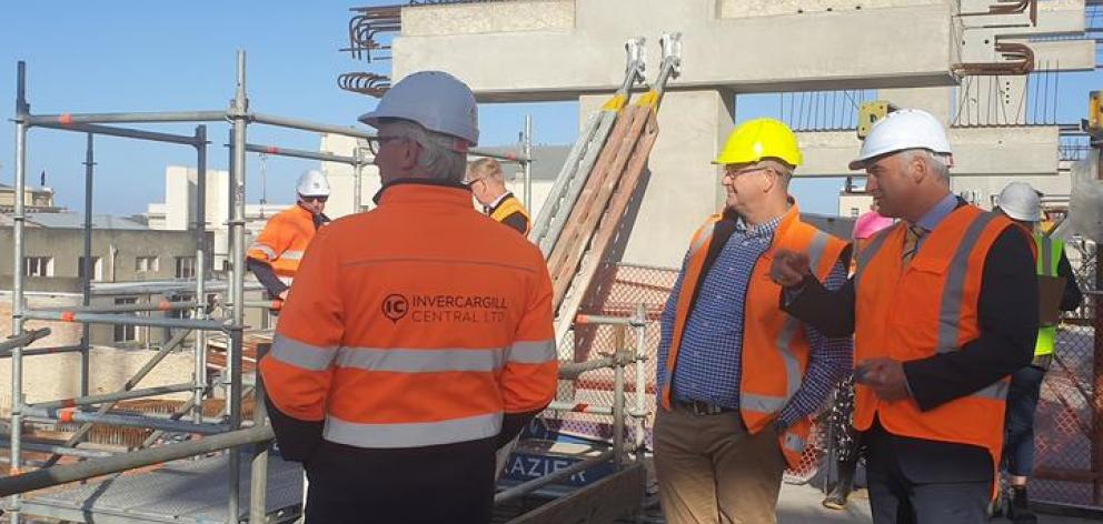 Regional Development Minister Stuart Nash reviewing progress at Invercargill's inner-city development with officials on Thursday. Photo: RNZ