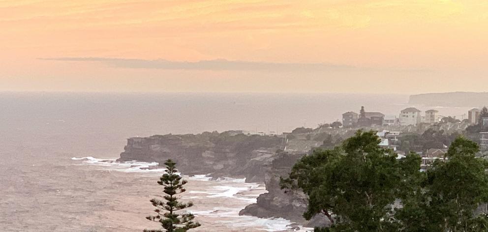 Sunset from the balcony at David and Imy's Love Home Swap apartment near Bondi, Sydney. Photos:...