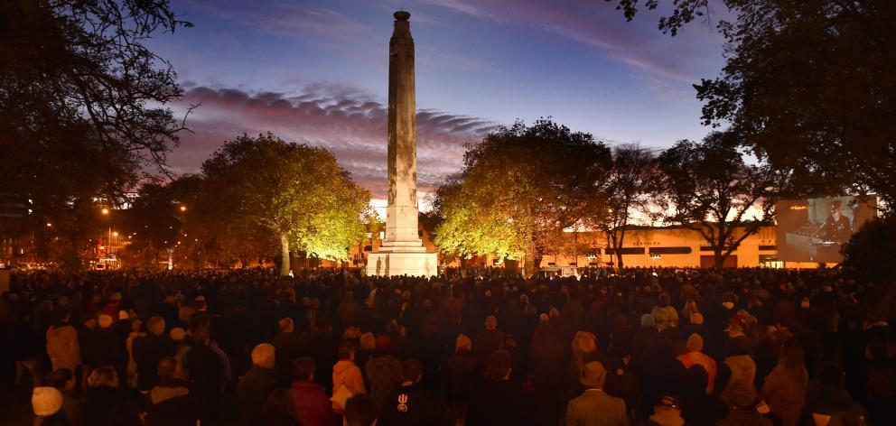 Dawn breaks over the cenotaph at Queens Gardens as thousands of people marked Anzac Day in...
