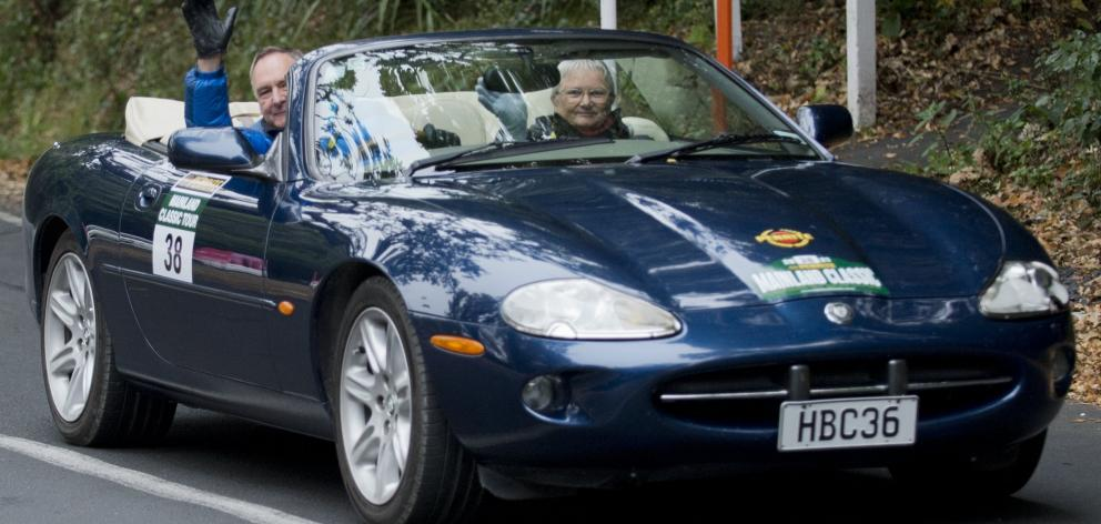 John and Wendy Gray, of Blenheim, head off with the top down in their Jaguar XK8.