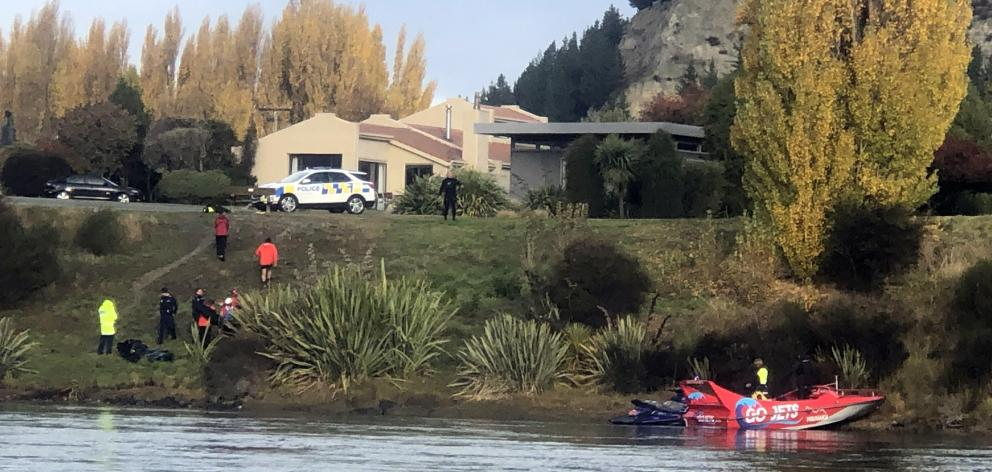 Wanaka Search and Rescue Swift Water team members and police retrieve the body of a man from the swift flowing Clutha River yesterday near the Albert Town bridge. Photo: Kerrie Waterworth