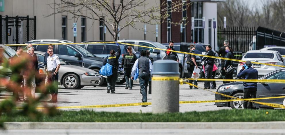 Investigators at the scene of a  mass shooting at a FedEx facility in Indianapolis. Photo: USA...