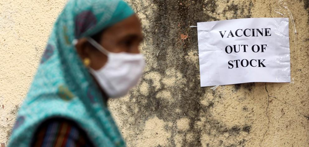 A notice about the shortage of coronavirus disease (COVID-19) vaccine supplies is seen at a vaccination centre, in Mumbai, India. Photo: Reuters