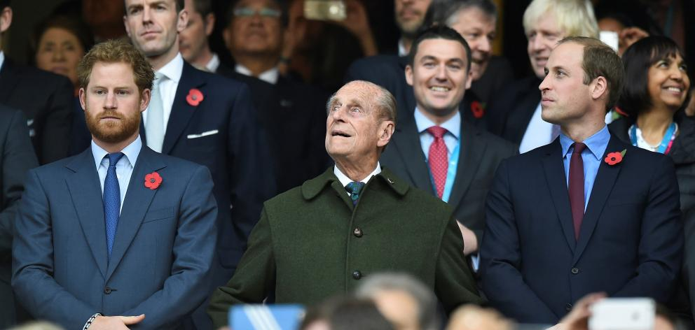 Prince Harry (left) Prince Philip and Prince William at the Rugby World Cup final match between...
