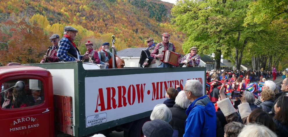 The Arrow Miners Band makes its way down Buckingham St.