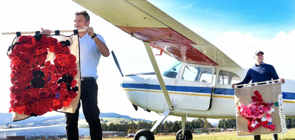 Moments after touching down, Poppy Flight Dunedin co-ordinator Vincent George (left) and pilot...