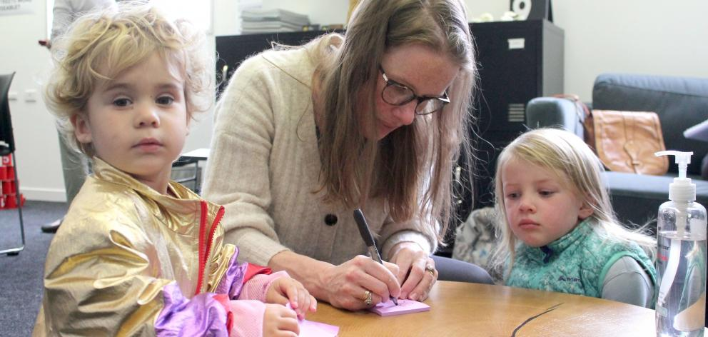 Rachael Devlin and her daughter Maeve (4), with Josie Coote (2), thinking about fun ideas for the...