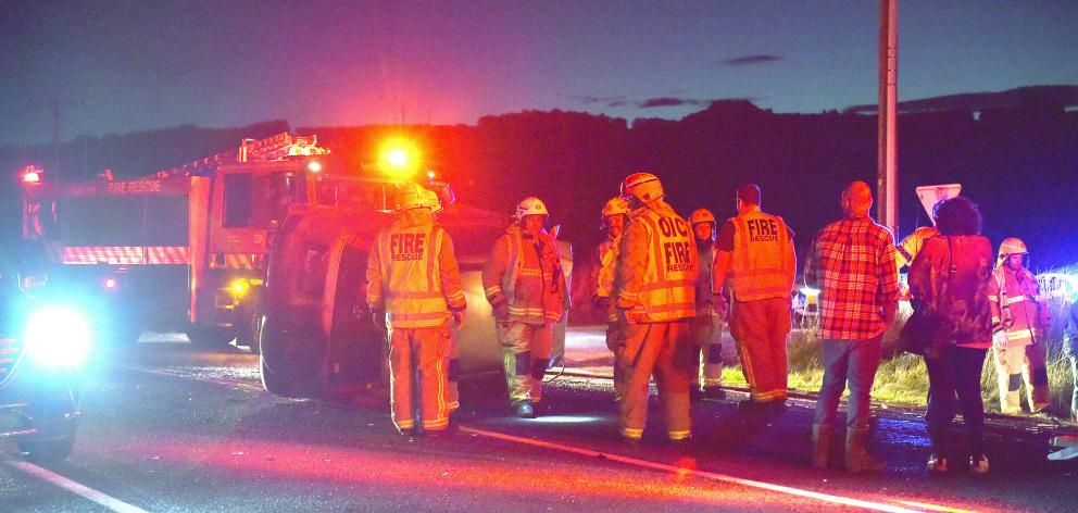 A car on its side on SH1 about halfway between Milton and Waihola at about 6.45pm tonight. PHOTO: Gregor Richardson