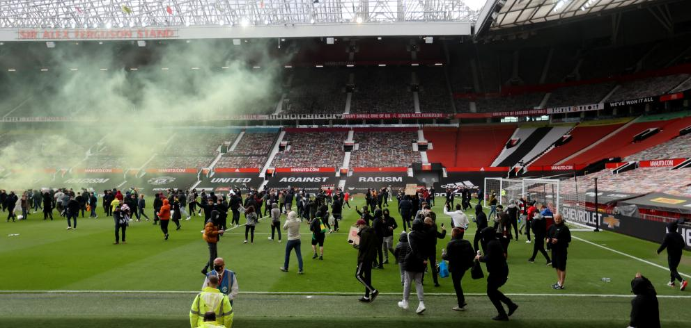 Manchester United fans protest against their owners before the Manchester United v Liverpool...