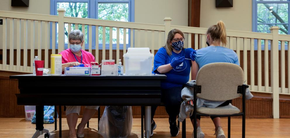 A girl with special needs receives the Covid vaccine in Pennsylvania last month. Widely...