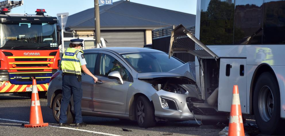 Emergency services at a crash between a car and a bus on Middleton Rd in Dunedin this morning. PHOTO: PETER MCINTOSH