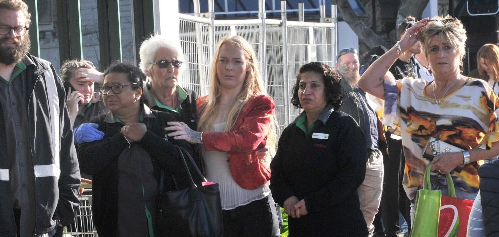 Staff and members of the public were visibly emotional as they waited for news about the stabbing...