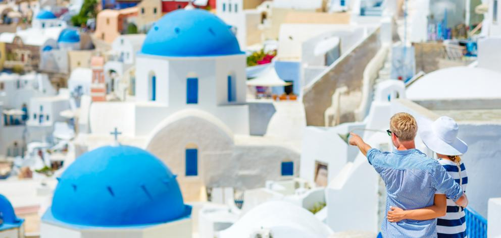Tourists in Santorini, Greece. Photo: Getty