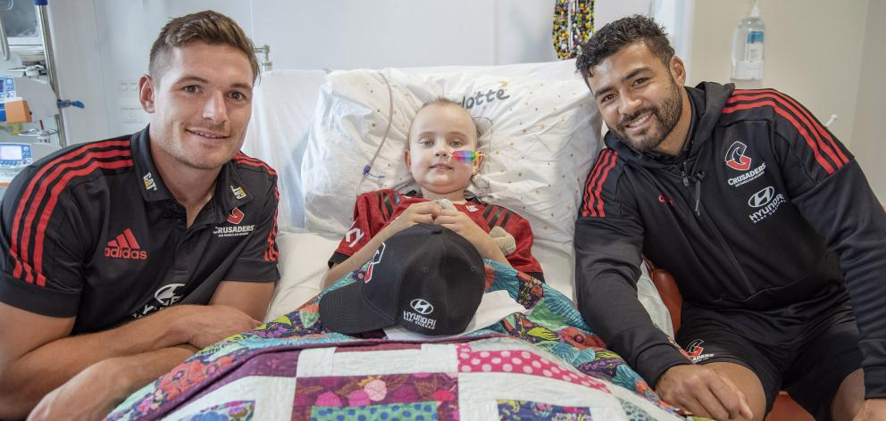 George Bridge and Richie Mo'unga with patients at the Children's Haematology and Oncology Centre....