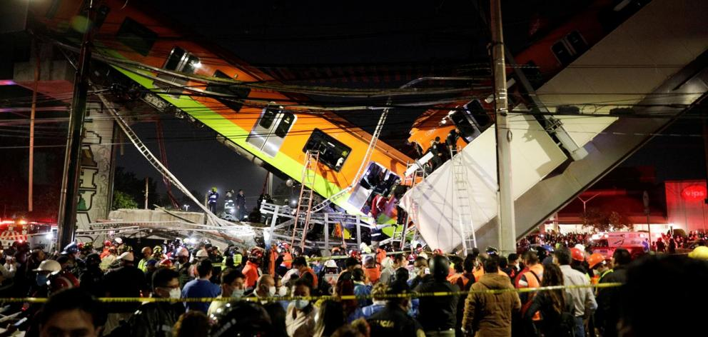Rescuers work at a site where an overpass for a metro partially collapsed with train cars on it at Olivos station in Mexico City. Photo: Reuters