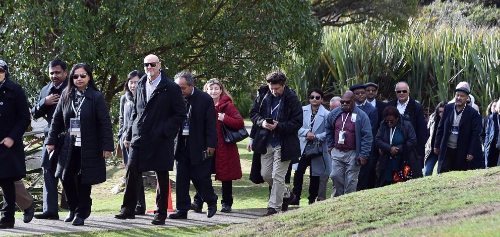 A group of ambassadors and high commissioners from 31 countries are led on to Otakou marae...