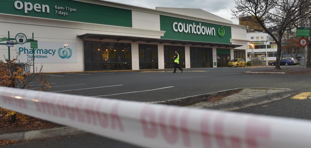 A security guard patrols the empty Countdown carpark this morning. PHOTO: PETER MCINTOSH