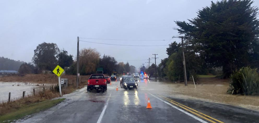 Flooding on the inland scenic route in Arundel, Canterbury. Photo: Rebecca Ryan