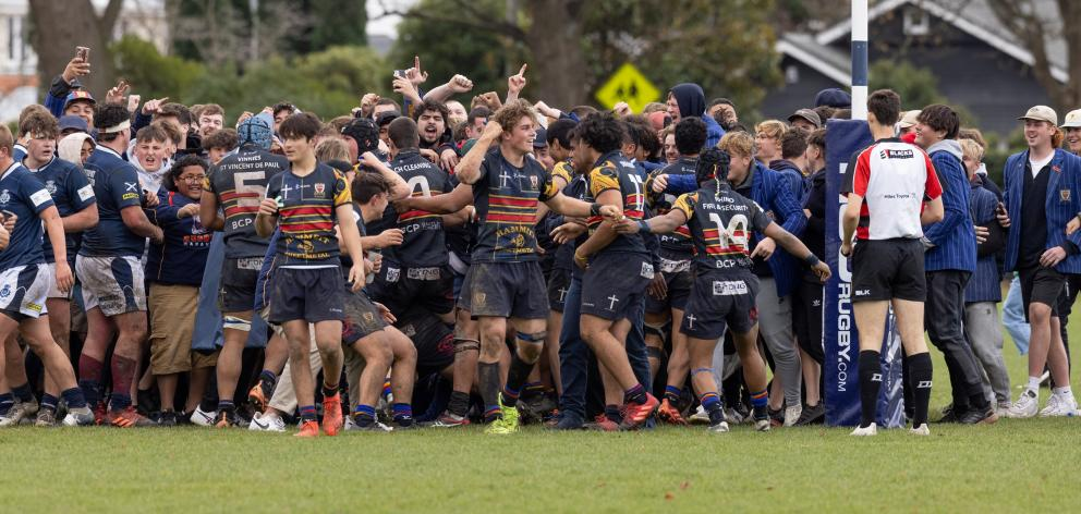 St Thomas of Canterbury College players and students celebrate a late go-ahead try against St...
