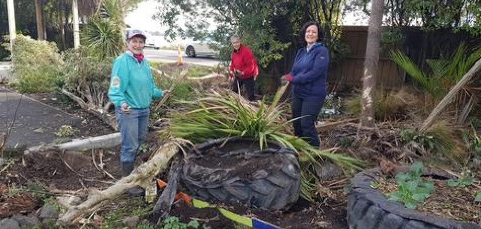 Cleaning up the damage at the Mt Pleasant community garden. Photo: Supplied