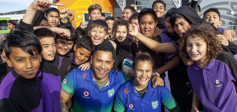 Ruben Wiki and Kiwi Ferns international Charlotte Scanlon surrounded by students at Te Waka Unua...