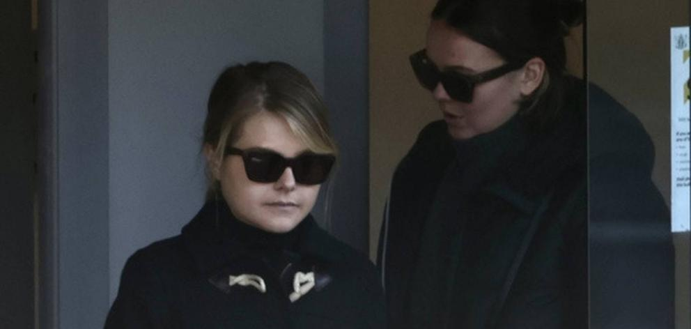 Tully Robinson (left), 22, leaves the Queenstown District Court supported by family members. Photo: George Heard