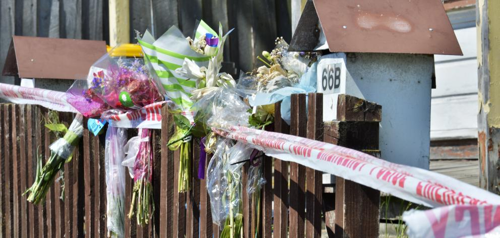 Flowers at the scene after the deaths of Anastasia Neve and David Clarke. Photo: Gerard O'Brien