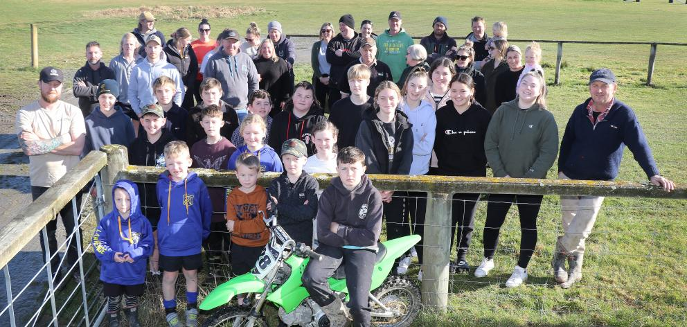 Lawrence Gymkhana Club president Paul Wilson stands at the right of a group demonstrating the depth of support from local families for the facility's motocross track, on Saturday. PHOTO: JOHN COSGROVE