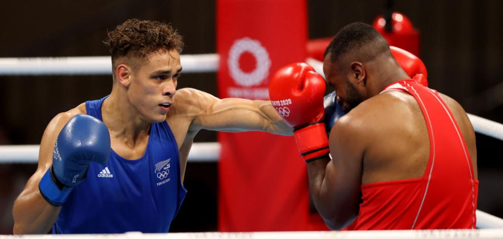 Youness Baalla (red) of Morocco defends as Kiwi Olympian David Nyika throws a punch. Photo: Getty Images