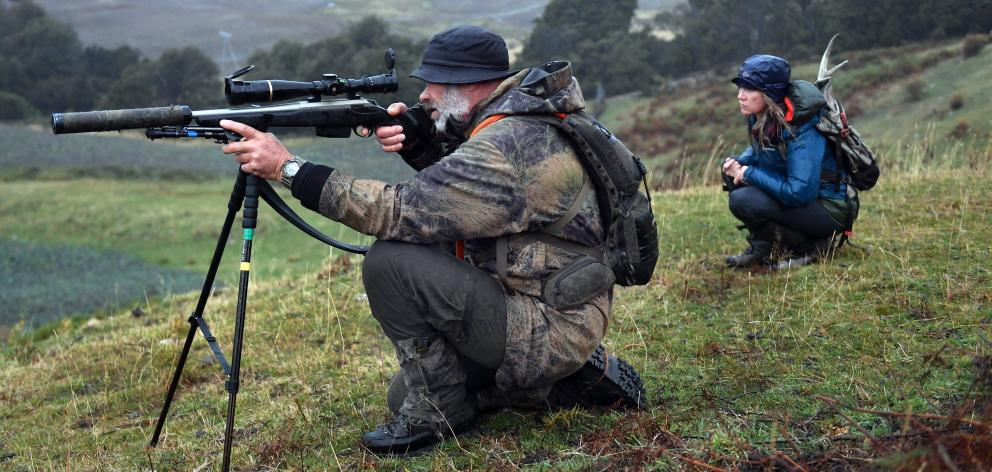 Hunting guide Tony Higgins decides not to fire at a doe because he could not guarantee the shot. ...