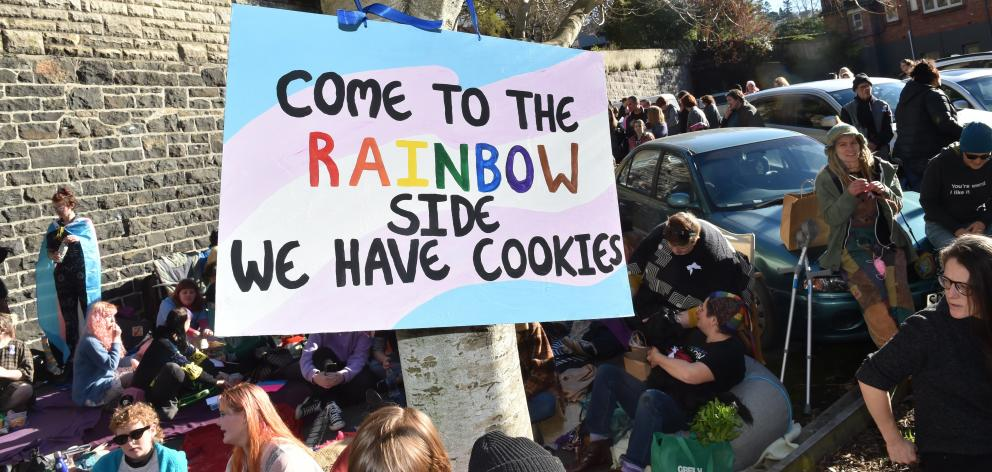 A crowd of about 150 supporters of the rainbow community gathered in protest against the Speak Up...