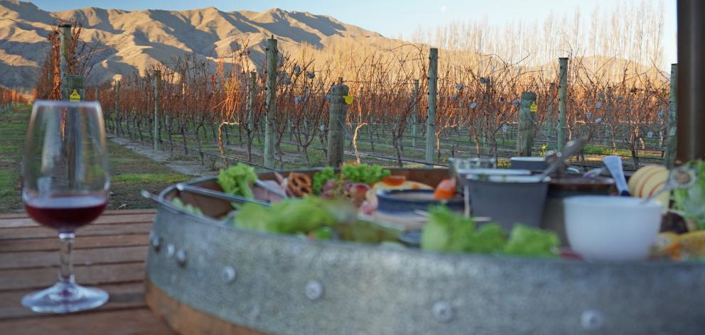 Sun catches on the hills, while enjoying a platter from River-T Winery.