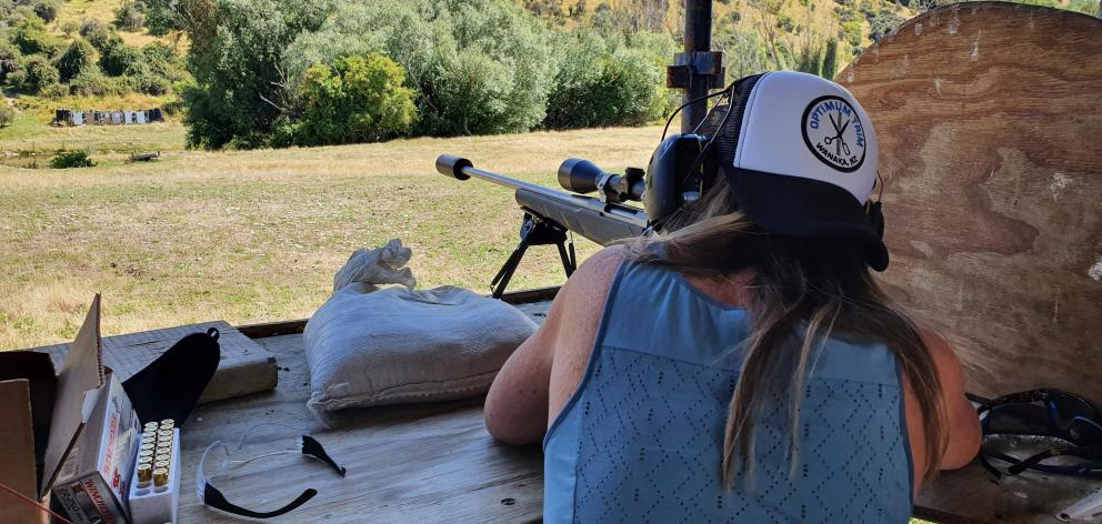 Lisa Scott tries her hand at shooting at the club range. PHOTO: JAMES MITCHELL