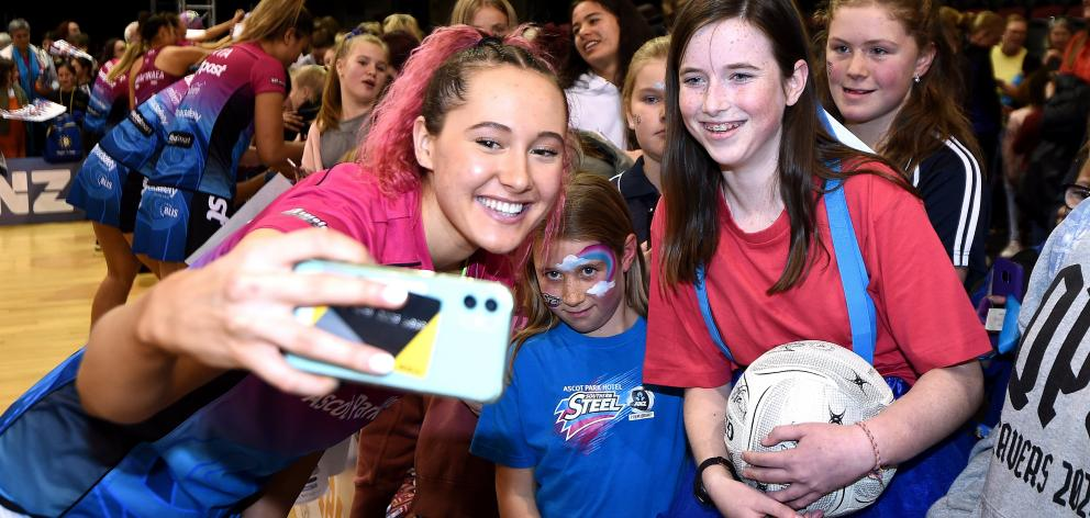 Steel shooter George Fisher poses for a photo with supporters during a game in Invercargill last...
