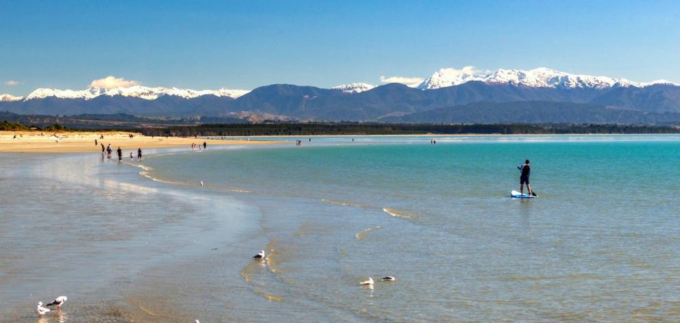 Winter paddleboarding at Tahunanui Beach, Nelson. PHOTO: NELSON TASMAN NZ
