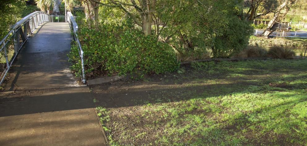 A footbridge in Hansen Park where one of the bins used to sit has high foot traffic, including...