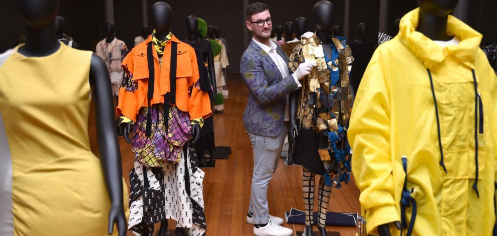 Otago Museum curator Craig Scott and ''Fashion FWD'' exhibits. PHOTO: GREGOR RICHARDSON