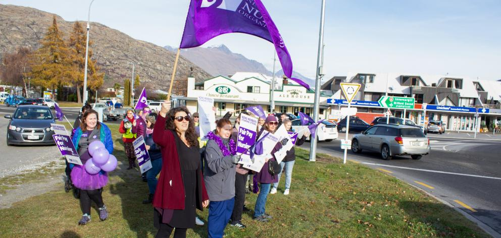 Nurses from Queenstown's Lakes District Hospital protest at the Frankton roundabout yesterday....