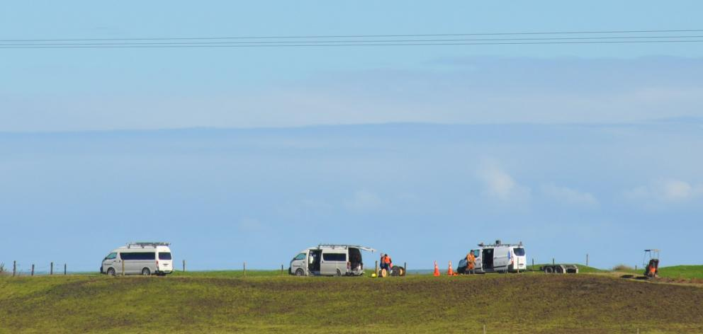 Contractors work to temporarily replace the damaged section of fibre cable that left more than...