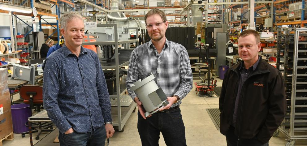 Escea co-founders (from left) Garth Milmine, Nigel Bamford and Alan McGregor in the factory —...