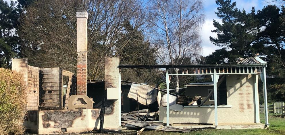 A fire destroyed this holiday home near Gimmerburn early today. Photo: Shannon Thomson