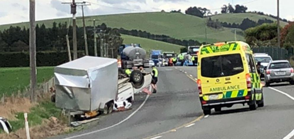 An ambulance attends a two-vehicle crash on State Highway 1 near Herbert yesterday afternoon,...